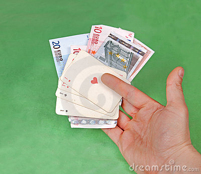Gambler s hand with four aces on green table