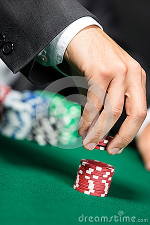 Gambler stakes the pile of poker chips