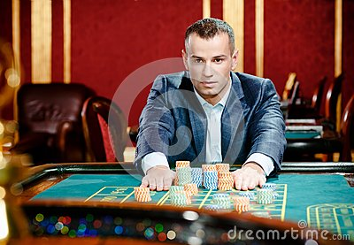 Gambler stakes playing roulette at the casino