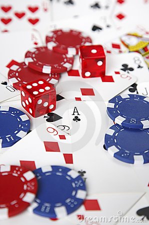 Gambling cards, chips and dice with shallow focus.