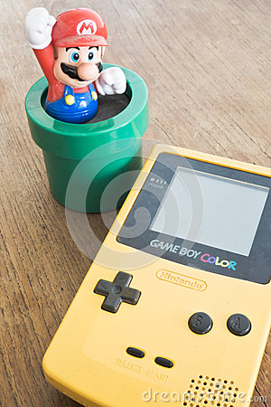 Free Game Boy Color Device With Super Mario Bros Figure Royalty Free Stock Photos - 55246408