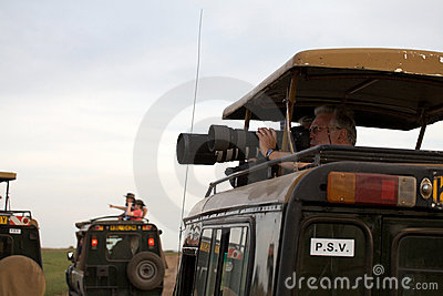 Game viewing vehicle and wildlife photographer Editorial Image