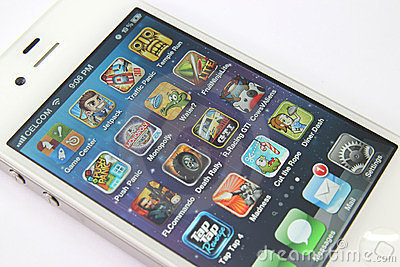 Games Apps on White iPhone 4S Editorial Image