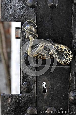 Gammalt guld- handtag för dörr