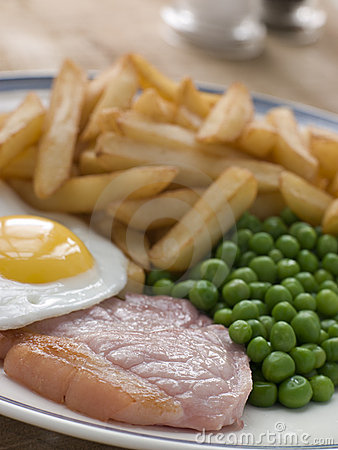 Free Gammon Steak Fried Egg Peas And Chips Stock Photography - 5629662