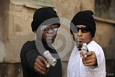 Gang members with guns on the street