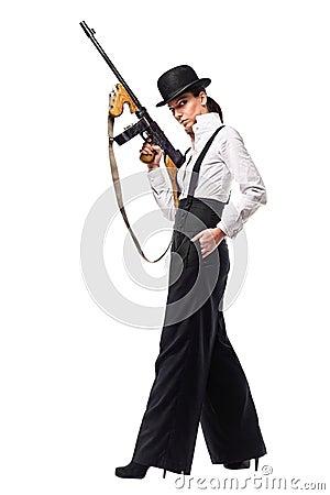 Gangster girl holding thompson machine gun.