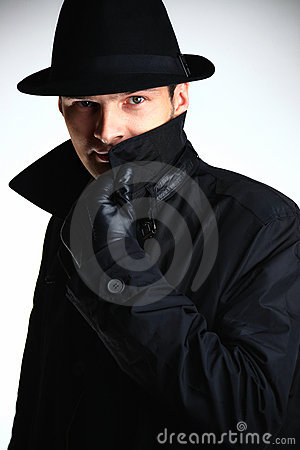 Gangster man in hat and coat