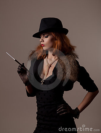 Gangster woman in fedora hat