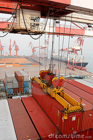 Free Gantry Crane Loads Container Onto Freighter Ship Royalty Free Stock Image - 13397696
