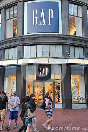 SAN FRANCISCO, USA - APRIL 8, 2014: Shoppers walk by Gap fashion store