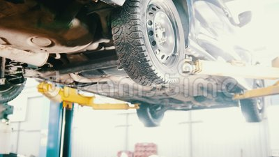 Garage automobile service - a mechanic checks the transmission, close up stock footage