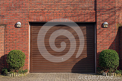 Garage door in brick wall