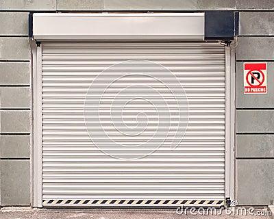 Garage door with no parking sign