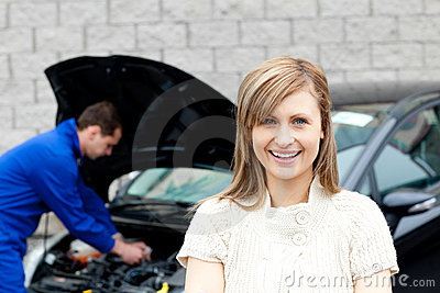 Garage mechanic repairing a car