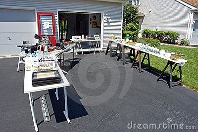 Garage Sale of Jumble Rummage Tables in House Yard