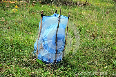 garbage bag in forest