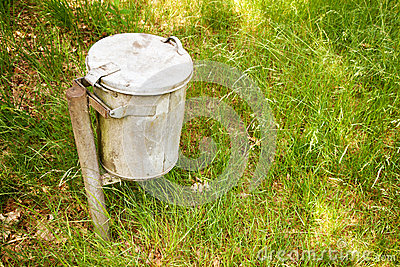 Garbage bin in the grass