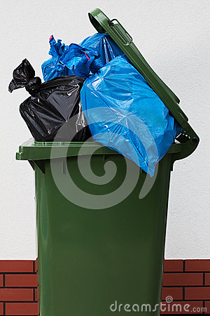 Garbage can over a white background