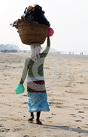 Garbage collector on the beach of Goa Editorial Stock Photo