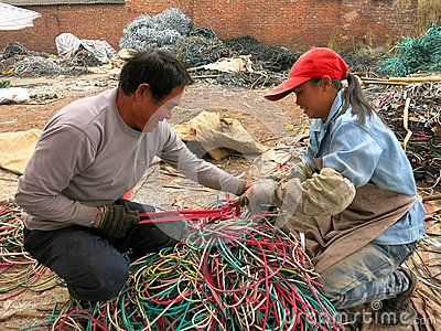 Garbage Recycling: Dealing With Wires Editorial Photography