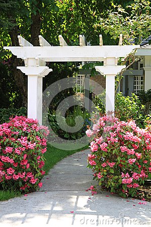 Free Garden Arbor And Pink Flowers. Royalty Free Stock Image - 24844106