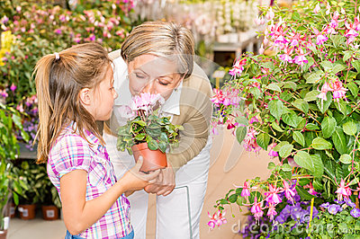 Garden center girl with grandmother smell flower