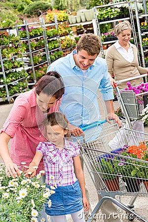 Garden centre family shopping flowers
