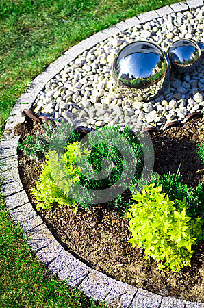 Garden decoration with silver mirror spheres
