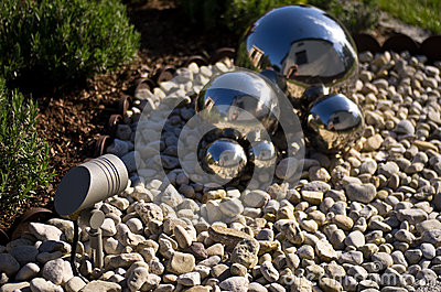 Garden decoration with silver mirror spheres