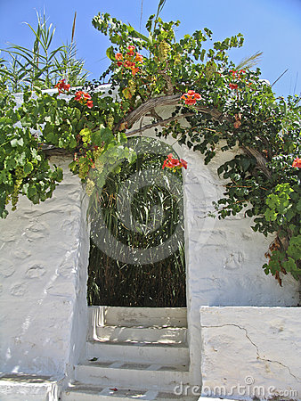 A garden entrance of a village house in Greece,