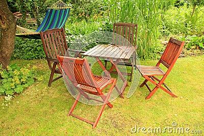 Garden furniture after a summer rain Stock Photo