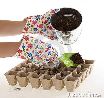 Garden Gloves, Shovel Placing Soil into Pots
