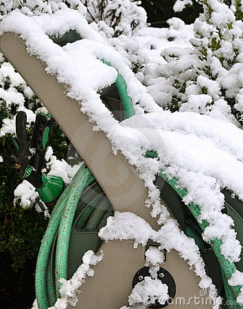 Garden hose covered in snow