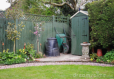 Garden Shed in an English Garden with compost bin