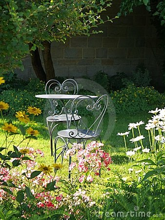 Garden: sunlit table and chairs
