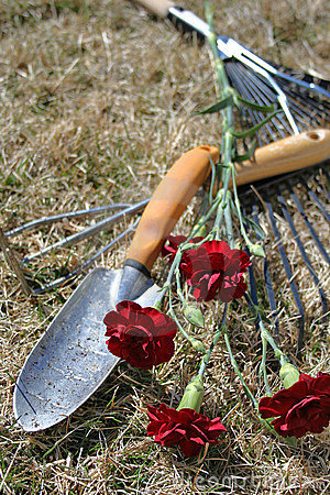 Garden Tools over dry grass background