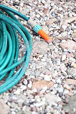 Garden water hose outdoor sand