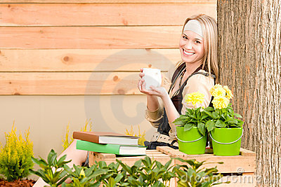 Garden woman terrace enjoy cup coffee spring