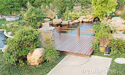 Garden with wood pergola and pond