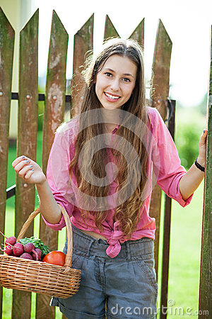 Gardener with a basket of vegetables