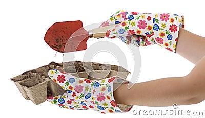 Gardener, Gloves, Shovel Putting Soil into Pots