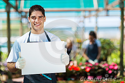 Gardener holding white board
