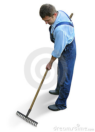 Gardener - worker in working clothes, raking the garden