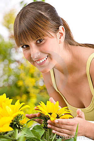Gardening - portrait of woman with sunflower