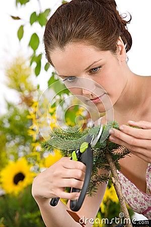Gardening - woman cutting tree with pruning shears