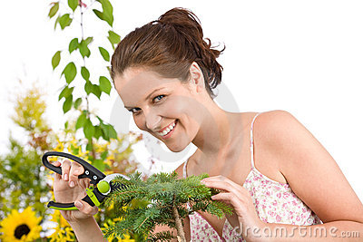 Gardening - woman cutting tree with shears