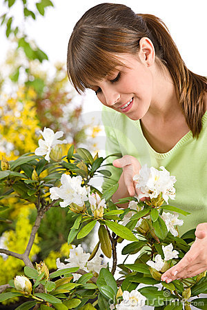 Gardening - woman with Rhododendron flower