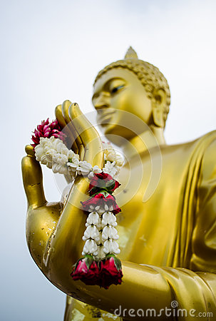 Garland in hand of buddha