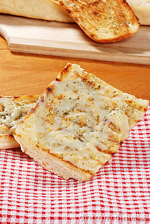 Garlic bread on red white checkered napkin